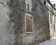 Years of history in the wall of a building in Zadar, Croatia.