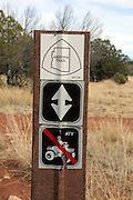 Signs along the Arizona Trail in Gardner Canyon in the Santa Rita Mountains of the Coronado National Forest in the Sonoran Desert north of Sonoita, Arizona, USA.