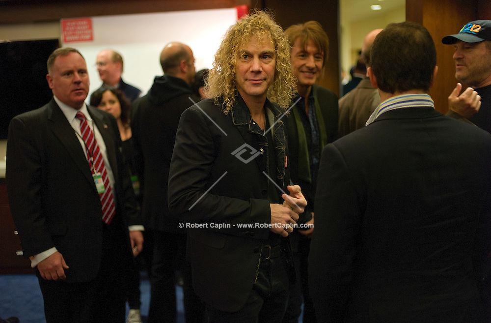 """David Bryan of Bon Jovi at a meet-and-greet. """"12-12-12?, a fundraising concert to aid the victims of Hurricane Sandy, will take place on December 12, 2012 at Madison Square Garden. The concert featured The Rolling Stones, Bon Jovi, Eric Clapton, Dave Grohl, Billy Joel, Alicia Keys, Chris Martin, Bruce Springsteen & the E Street Band, Eddie Vedder, Roger Waters, Kanye West, The Who, and Paul McCartney. All the proceeds went go to the Robin Hood Relief Fund. Robin Hood, the largest independent poverty fighting organization in the New York area, will insure that every cent raised will go to non-profit groups that are helping the tens of thousands.of people throughout the tri-state area who have been affected by Hurricane Sandy...Photo © Robert Caplin.."""