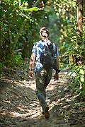 Volunteer scouting for wildlife, Manu National Park, Peru, South America
