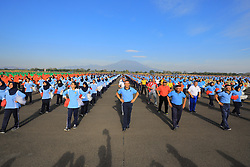 September 4, 2018 - Magetan, East Java, Indonesia - 5000 members of Indonesia National Army (TNI) and Indonesia Police (POLRI) dancing Gemu Famirre at the main appron of Iswahjudi Air Force Base Magetan, September 4th, 2018.This event involve 346.829 member of Indonesia National Army and Indonesia Police. Mass Gemu Famire Dance held to celebrate 73rd birthday of Indonesia National Army and to achieve the record of mass gemu famire dance register in the Museum World Record of Indonesia. (Credit Image: © Hendro Wahyu Setyono/Pacific Press via ZUMA Wire)