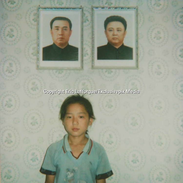 NORTH KOREA POLAROIDS<br /> <br /> Photographer Eric Lafforgue first went in North Korea in 2008. At this time, there was no mobile phone in the country, and the only pics people were taking were thanks to the official photographers who stood at the entrance of the main monuments, to sell some photo souvenirs to visitors. <br /> <br /> I first thought about making Polaroids just as a kind of artistic work, to keep the dull colors of this country, but quickly i discovered this camera was the best way to make contacts with locals and to break the ice.<br /> <br /> Everytime i was taking a polaroid, i was taken another one i offered to my north korean «model».<br /> <br /> So many times, this allowed me to see north koreans in a very different way, and to start some conversations, thru my guide, of course. Something that was no allowed in 2008.<br /> <br /> I think the ones who loved the most the Polaroids were the soldiers! At the DMZ, the whole unity stood one by one in front of the camera. First the colonel did not want to allow me to disturb the mission they had: monitoring South Korea. But when i did one of a soldier, he came back and ordered me to take one for him!<br /> Another colonel lead me to the top of the DMZ building to pause: he wanted to show his wife where he was working.<br /> It was so funny to see them lose the stiff attitud they are supposed to keep everytime.<br /> <br /> When visiting some houses, i asked the people where they wanted to stand for the picture, everybody answered «below the dear leaders portraits». Once, i had to do the Polaroid again as the Leaders portraits were cut. Unacceptable.<br /> <br /> For many, they had never see the development of a Polaroid, specially in the countryside where the only pics people own are the ones of the Dear Leaders (an obligation by the way!). So when i gave Polaroids to farmers, they were really happy. One of them even offered me 1 peach to thank me. In 2008, it was a very valuable gift for a north k