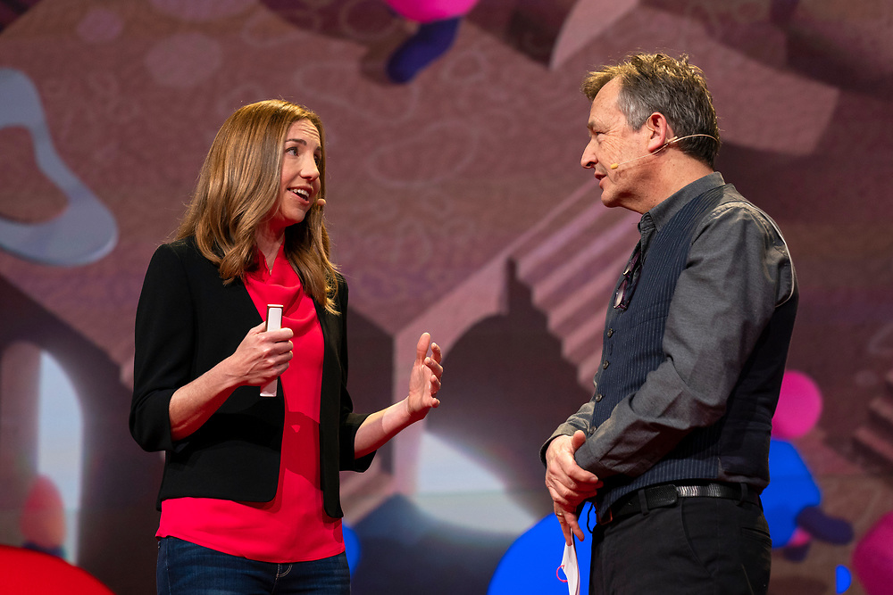 Elizabeth Dunn and Host Chris Anderson speak at TED2019: Bigger Than Us. April 15 - 19, 2019, Vancouver, BC, Canada. Photo: Bret Hartman / TED