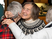 Longtime valley resident Inger Koedt gets a hug from friend Jean Jorgensen on Friday at her 100th birthday party at Frank and Patty Ewing's home in east Jackson. The centenarian and her late husband Bobs Koedt helped Jews in Denmark evade Germans in World War II before moving to America and eventually to Jackson Hole in 1956.