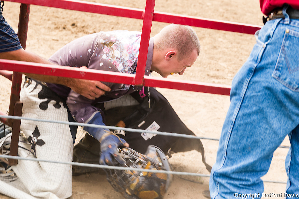 The bull was nearly too much for this young man, who staggered away after being thrown and collapsed.