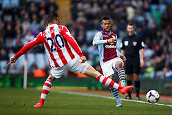 Aston Villa Defender Ryan Bertrand (ENG) is challenged by Stoke Defender Geoff Cameron (USA) - Photo mandatory by-line: Rogan Thomson/JMP - 07966 386802 - 23/03/2014 - SPORT - FOOTBALL - Villa Park, Birmingham - Aston Villa v Stoke City - Barclays Premier League.