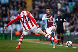Aston Villa Defender Ryan Bertrand (ENG) is challenged by Stoke Defender Geoff Cameron (USA) - Photo mandatory by-line: Rogan Thomson/JMP - 07966 386802 - 23/03/2014 - SPORT - FOOTBALL - Villa Park, Birmingham - Aston Villa v Stoke City - Barclays Premier League.