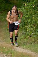 New Paltz, New York - Jason Beaupre runs through the Mohonk Preserve during the Shawangunk Ridge Trail Run/Hike 20-mile race  on Sept. 20, 2014.