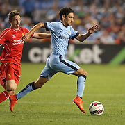 Jesús Navas, (right), Manchester City, challenged by Joe Allen, Liverpool, during the Manchester City Vs Liverpool FC Guinness International Champions Cup match at Yankee Stadium, The Bronx, New York, USA. 30th July 2014. Photo Tim Clayton