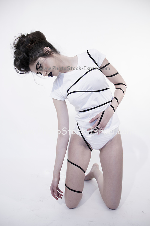 Religious Compulsion concept. Woman wrapped in leather straps resembling Phylacteries straps