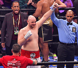 January 26, 2019 - Brooklyn, New York, USA - ADAM KOWNACKI (white and red trunks) celebrates after defeating GERALD WASHINGTON in a heavyweight bout at the Barclays Center in Brooklyn, New York. (Credit Image: © Joel Plummer/ZUMA Wire)