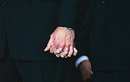 President Bill Clinton and First Lady Hilary Clinton hold hands during th months of the Clinton impeachment drama.<br />Photo by Dennis Brack