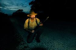 Dairen Simpson prepares to check the traps at sunrise near the villae of Mnolela, Tanzania. Ami Vitale