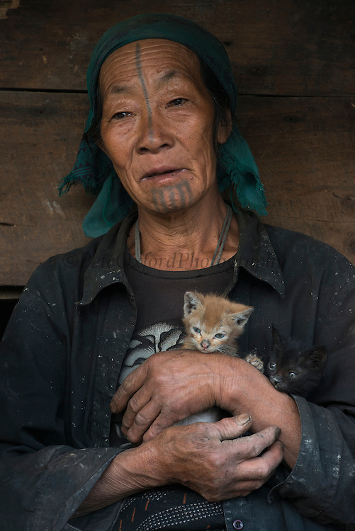 Apatani woman & facial tattoos<br /> Apatani Tribe<br /> Ziro Valley, Lower Subansiri District, Arunachal Pradesh<br /> North East India