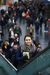 © Licensed to London News Pictures. 09/01/2017. London, UK. Commuters walk from Waterloo station to cross The Golden Jubilee footbridge as a 24 hour London Underground tube strike takes hold.  All Zone one tube stations are closed until 6PM tonight after members of the RMT and the Transport Salaried Staffs' Association unions walked out after talks with TFL collapsed.  Photo credit: Peter Macdiarmid/LNP