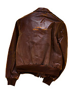 """This is a type A2 flight jacket that was worn by members of the 390th bombardment group. This jacket does not have a squadron patch or name plate on the front to identify who the jacket belonged to, or which squadron they were attached to. On the back of the jacket the name """"Hell Cats"""" is painted in yellow."""
