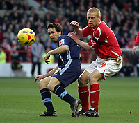 Photo: Paul Thomas.<br /> Nottingham Forest v Leyton Orient. Coca Cola League 1. 16/12/2006.<br /> <br /> Forest's Gary Holt (R) tries to tackle Craig Easton.