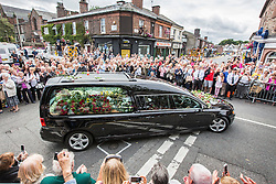 © Licensed to London News Pictures. 20/08/2015. Liverpool, UK. Picture shows Cilla Black's funeral cortege travelling through the streets of Wootlon in Merseyside to the stars funeral at St Mary's church. Photo credit: Andrew McCaren/LNP