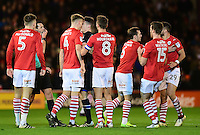 Barnsley's Marc Roberts and Blackburn Rovers' Darragh Lenihan square up to each other as Referee Andrew Madley prepares to show the Blackburn Rovers player a red card<br /> <br /> Photographer Chris Vaughan/CameraSport<br /> <br /> The EFL Sky Bet Championship - Barnsley v Blackburn Rovers - Monday 26th December 2016 - Oakwell Stadium - Barnsley<br /> <br /> World Copyright © 2016 CameraSport. All rights reserved. 43 Linden Ave. Countesthorpe. Leicester. England. LE8 5PG - Tel: +44 (0) 116 277 4147 - admin@camerasport.com - www.camerasport.com