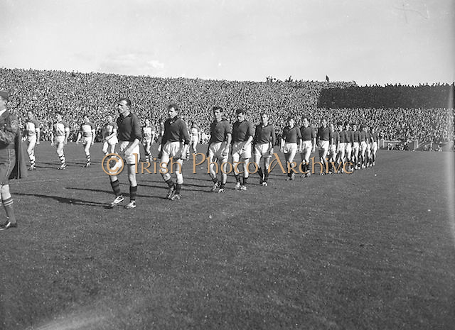 Teams line out onto the pitch before the All Ireland Senior Gaelic Football Final Down v. Offaly in Croke Park on the 24th September 1961.