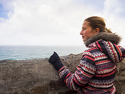 Girl admiring scenic seascape over the Bay of Biscay