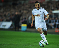 Swansea City's Neil Taylor in action during todays match  <br /> <br /> Photographer Kevin Barnes/CameraSport<br /> <br /> Football - Barclays Premiership - Swansea City v Liverpool - Monday 16th March - The Liberty Stadium - Swansea<br /> <br /> © CameraSport - 43 Linden Ave. Countesthorpe. Leicester. England. LE8 5PG - Tel: +44 (0) 116 277 4147 - admin@camerasport.com - www.camerasport.com