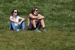 © Licensed to London News Pictures. 11/04/2020. London, UK. People sunbathing on Primrose Hill, London over Easter Bank holiday weekend, during a pandemic outbreak of the Coronavirus COVID-19 disease. The public have been told they can only leave their homes when absolutely essential, in an attempt to fight the spread of coronavirus COVID-19 disease. Photo credit: Ben Cawthra/LNP
