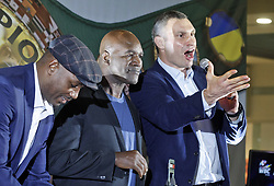 October 2, 2018 - Kiev, Ukraine - Former Boxing Champion LENNOX LEWIS (L), former Boxing Champion EVANDER HOLYFIELD (C) and former heavyweight boxing champion and current Mayor of Kiev VITALI KLITSCHKO (R) greet supporters during an authographs session for supporters at the 56th World Boxing Convention in Kiev, Ukraine, on 2 October 2018.The WBC 56th congress in which take part boxing legends Evander Holyfield,Lennox Lewis, Eric Morales and about 700 participants from 160 countries runs in Kiev from from September 30 to October 5. (Credit Image: © Serg Glovny/ZUMA Wire)