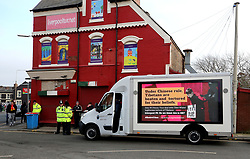 A digital advertising display van protesting Chinese rule in Tibet and Liverpool owner John W. Henry's deal with Tibet Water outside the ground before the Premier League match at Anfield, Liverpool.