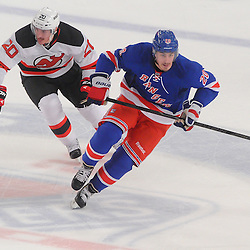 May 16, 2012: New York Rangers left wing Chris Kreider (20) out skates New Jersey Devils center Ryan Carter (20) to the puck during first period action in game 2 of the NHL Eastern Conference Finals between the New Jersey Devils and New York Rangers at Madison Square Garden in New York, N.Y.