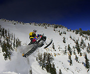Tim Hoff sends his Skidoo airborne in the backcountry of the Snake River range, Wyoming