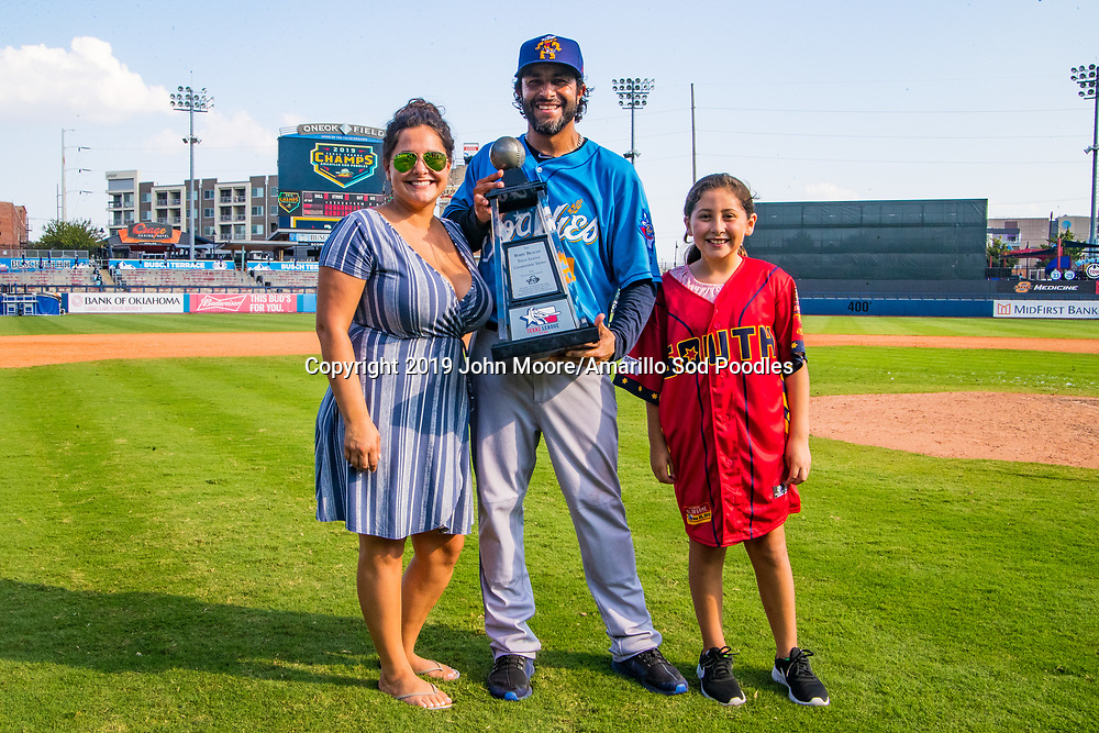 Amarillo Sod Poodles fielding coach Freddy Flores poses with the trophy after the Sod Poodles won against the Tulsa Drillers during the Texas League Championship on Sunday, Sept. 15, 2019, at OneOK Field in Tulsa, Oklahoma. [Photo by John Moore/Amarillo Sod Poodles]