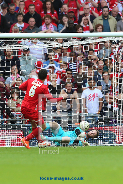 Adam Collin of Rotherham United saves a penalty from Mathieu Baudry of Leyton Orient during penalty  shootout in the Sky Bet League 1 match at Wembley Stadium, London<br /> Picture by Richard Calver/Focus Images Ltd +447792 981244<br /> 25/05/2014