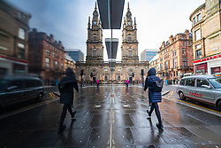Glasgow, Scotland, UK. 12 March 2021. On the day Covid-19 lockdown is relaxed slightly in Scotland the city centre streets in Glasgow city centre remain almost deserted virtually all shops ad cafes are still closed. Pic;  Reflection of Tron Church in city centre. Iain Masterton/Alamy Live News