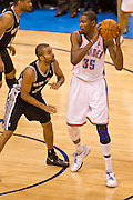 June 2, 2012; Oklahoma City, OK, USA; Oklahoma City Thunder forward Devin Durant (35) looks to make a pass under pressure from San Antonio Spurs guard Tony Parker (9) during a playoff game  at Chesapeake Energy Arena.  Thunder defeated the Spurs 109-103 Mandatory Credit: Beth Hall-US PRESSWIRE