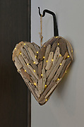 Many individual pieces of wood are brought together in a heart shape in this present from the Glen's daughter, who lives in Colorado. LED lights on a battery provide the tiny points of light. Sheridan and Rikki Glen are At Home in their Tanglewood subdivision home in Caseyville, IL on Wednesday January 16, 2019. <br /> Photo by Tim Vizer