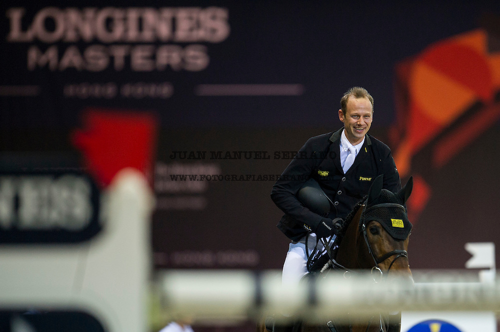 Marco Kutscher on Van Gogh celebrates winning Longines Grand Prixat the Longines Masters of Hong Kong on 21 February 2016 at the Asia World Expo in Hong Kong, China. Photo by Juan Manuel Serrano / Power Sport Images