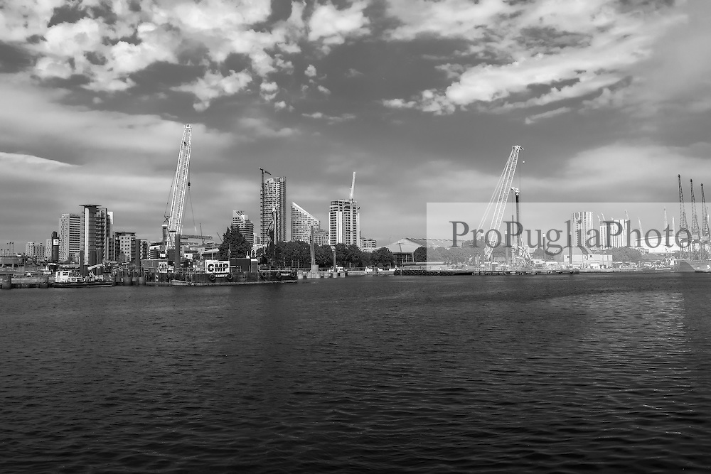 Canary Wharf. Cranes have become a symbol of London skyline, a costant presence that is evolving London cityscape.