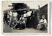 friends posing in front of a sedan car France 1930s