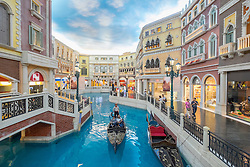 Canal and Gondola on canal inside The Venetian Macao  casino and hotel in Macau China