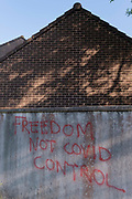 With reports of a third Coronavirus pandemic wave, anti-Covid government control graffiti - Freedom Not Covid Control - has been sprayed on a suburban towns wall, on 31st May 2021, in Nailsea, North Somerset, England.