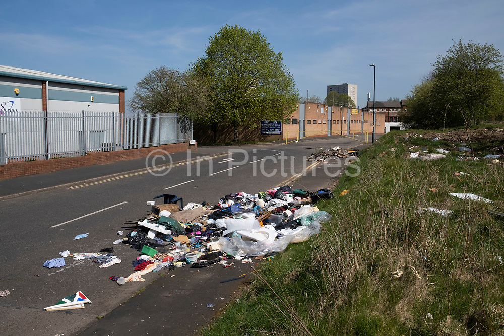 Fly tipping rubbish on an industrial estate in Ladywood on 15th April 2020 in Birmingham, England, United Kingdom. Illegal dumping, also called fly dumping or fly tipping, is the dumping of waste illegally instead of using an authorised method such as kerbside collection or using an authorised rubbish dump. It is the illegal deposit of any waste onto land, including waste dumped or tipped on a site with no licence to accept waste.