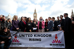 © Licensed to London News Pictures. 14/02/2013. London, UK. Women and men gather in Parliament Square, London today (14/02/13) to remember the 109 women killed through domestic violence in the UK as part of the 'One Billion Rising' campaign. The campaign takes its name from the statistic stating that one in three women will be raped or beaten in their lifetime (equating to one billion women). Photo credit: Matt Cetti-Roberts/LNP