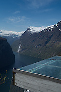 Waterfalls from melting snow cascade off the mountainsides at Geiraingerfjord  on May 18, 2013.  An overlook is along the Eagle Road, which has 11 hairpin turns. Geirangerfjord is among UNESCO World Heritage sites.  (© 2013 Cindi Christie)