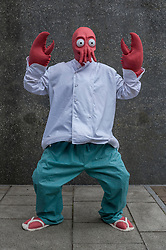 © Licensed to London News Pictures. 24/05/2015. London, UK. A man dressed as Doctor Zoidberg from Futurama poses, as fans of anime, comic books, video games and more gather in large numbers at the Excel Centre to attend the bi-annual MCM Comic Con. Photo credit : Stephen Chung/LNP