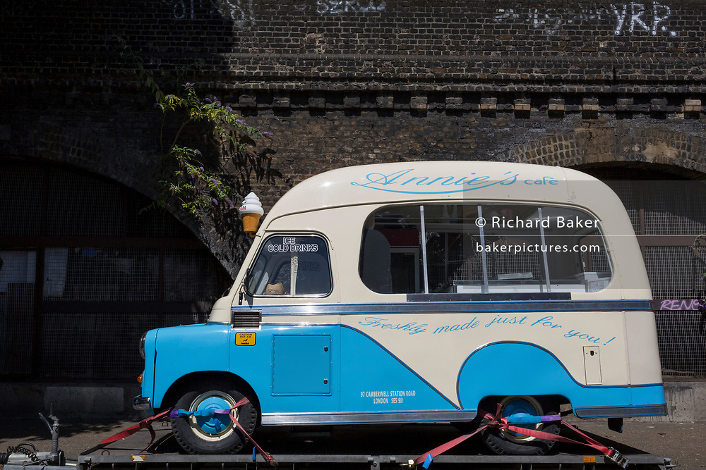 A Bedford ice cream van sits on a trailer under railway arches in Camberwell, on 5th July 2017, in London, England.