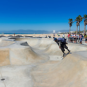 Skateboarder in Venice skate park, LA, California