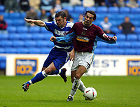 Fotball<br /> 2004/2005<br /> Foto: SBI/Digitalsport<br /> NORWAY ONLY<br /> <br /> Reading v Burnley<br /> The League Championship. 02/10/2004<br /> <br /> Graeme Murty of Reading clashes with Jean Louis Valois of Burnley