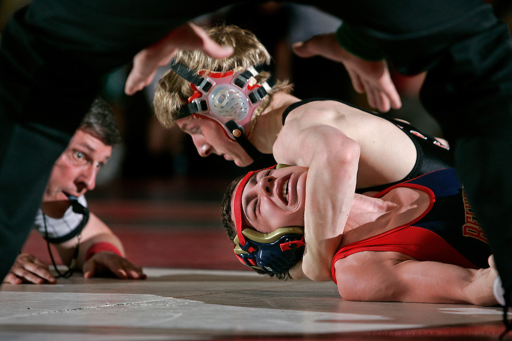 SCOTT MORGAN   ROCKFORD REGISTER STAR.Harlem High School's Derek Elmore (top) works to pin Belvidere North's Greg Adkins in the 103-pound first place final Saturday, Jan. 31, 2009, during the NIC-10 Conference Wrestling Championships at East High School in Rockford.