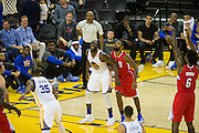 Golden State Warriors forward Draymond Green (23) laughs with Los Angeles Clippers forward Alan Anderson (9) during a free throw attempt during a NBA preseason game at Oracle Arena in Oakland, Calif., on October 4, 2016. (Stan Olszewski/Special to S.F. Examiner)